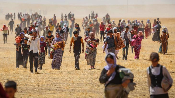 Yazidis fleeing IS in Iraq (photo: picture-alliance/AA/E. Yorulmaz)