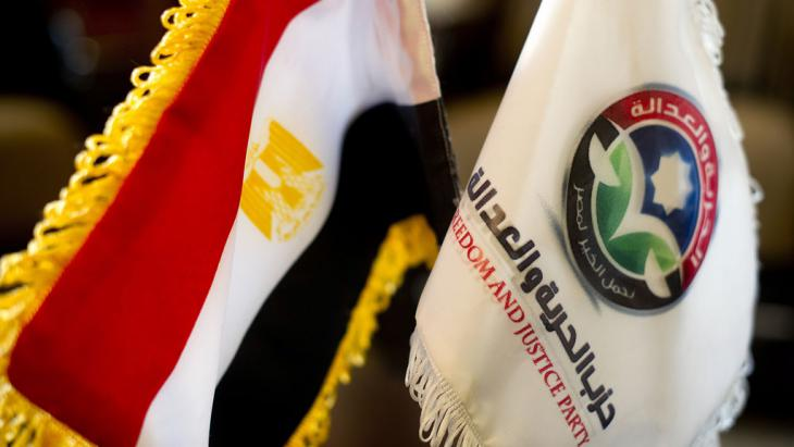 Egyptian flag next to a flag of the Freedom and Justice Party (photo: AFP/Getty Images)