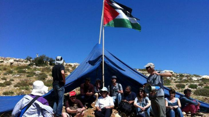 Activists from the Combatants for Peace group protesting against the expansion of an Israeli settlement (photo: Itmar Feigenbaum)