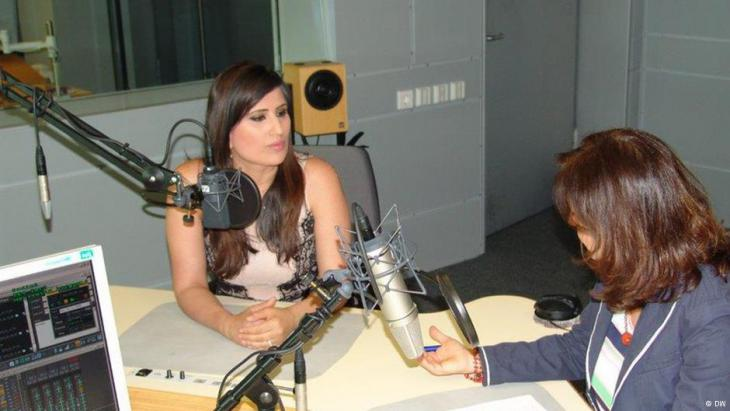 Naghme Abedini giving a radio interview (photo: DW)