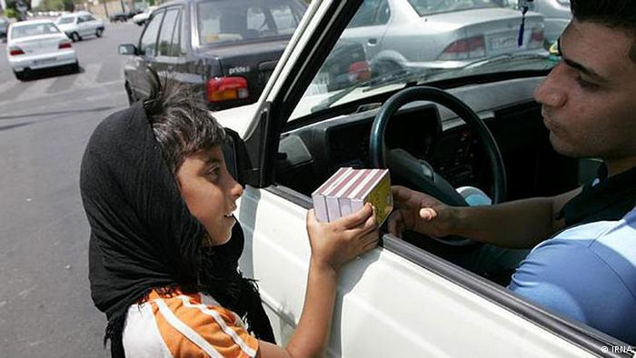 A child selling matches on a street in Tehran (photo: IRNA)