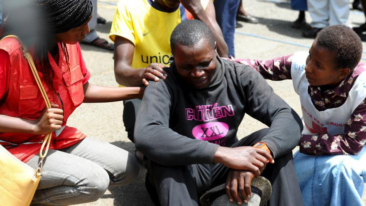 A man in distress after the attack on Garissa University in April 2015 (photo: Reuters/Herman Kairuki)