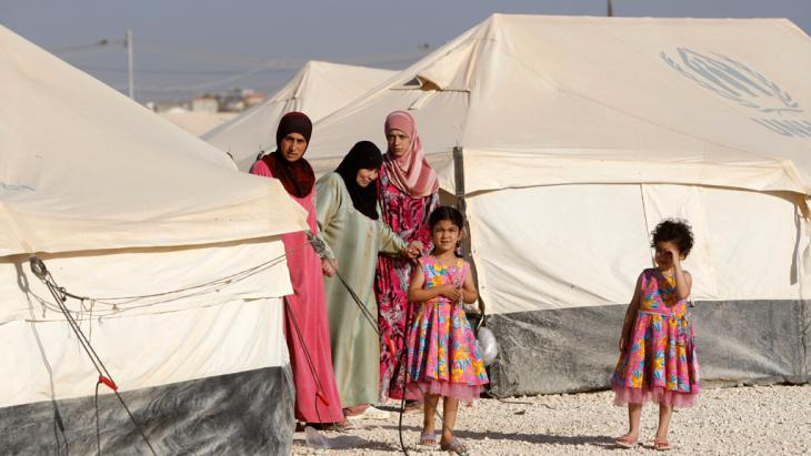 Women and children in Zaatari refugee camp (photo: Getty Images)