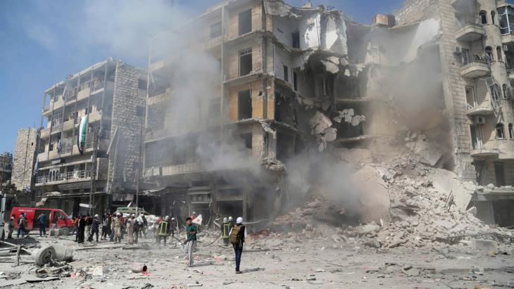 The aftermath of a barrel bomb attack in Aleppo