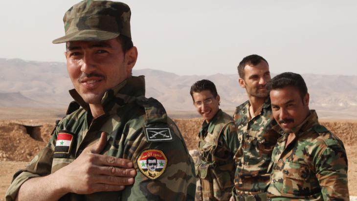 Soldiers loyal to the Assad regime (photo: picture-alliance(dpa/Dimitriy Vinogradov)