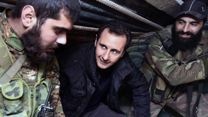 Syria's president Bashar al-Assad visiting troops in Damascus (photo: AP)