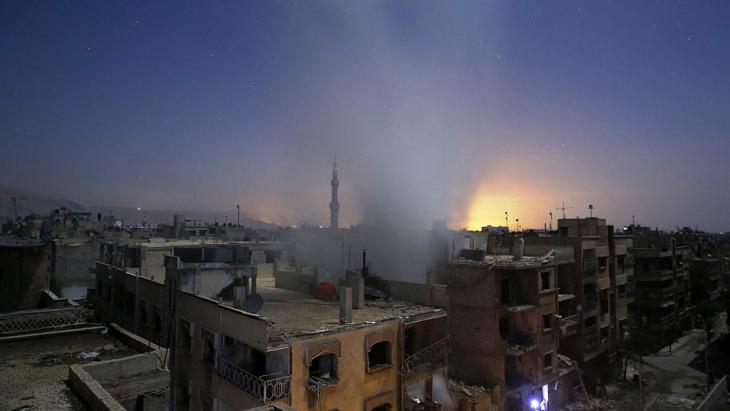 Regime shells hit Douma, east of Damascus on 30 October (photo: Getty Images/AFP/S. Al-Doumy)