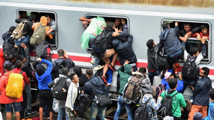 Refugees attempting to board an overcrowded train in Tovarnik, Croatia (photo: Getty Images/J. J. Mitchell)