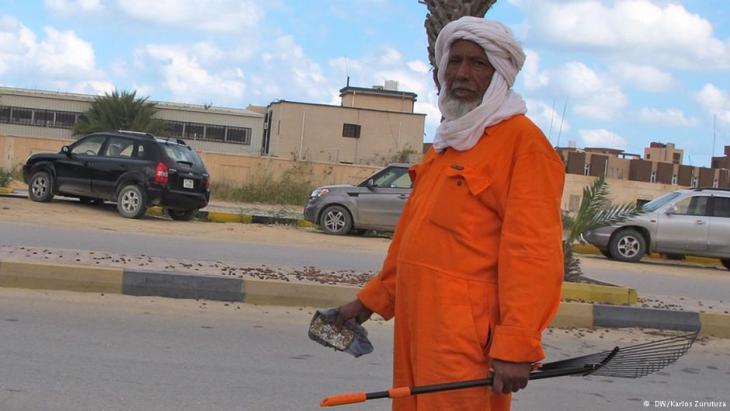 Issa, a Touareg tribesman, in an orange jumpsuit