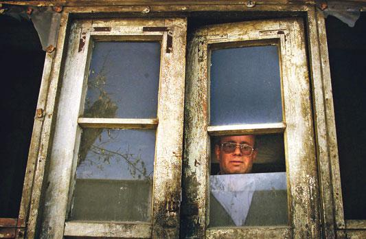 Zebulon Simentov, the last Jew of Kabul, looking out of the window (photo: Reuters)