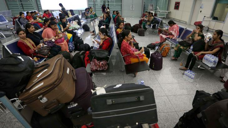 Indian nurses held hostage in Iraq return home (photo: SAFIN HAMED/AFP/Getty Images)