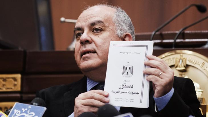 Amr Darrag, secretary general of the constituent assembly, presents a draft of the new Egyptian constitution in December 2012 (photo: Getty Images/AFP/G. Guercia)