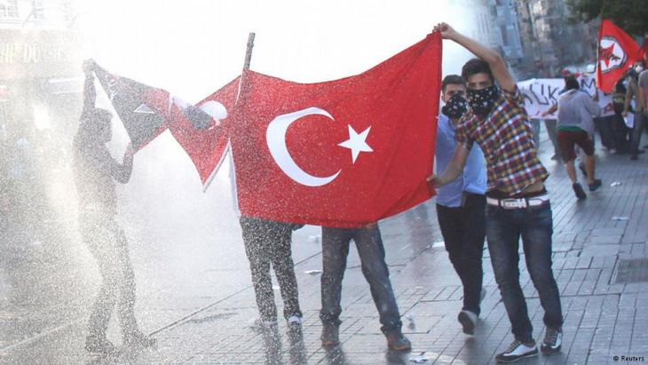 Police sprayed water cannon to disperse dozens of people in front of the offices of Kanalturk and Bugun TV (photo: REUTERS/Murad Sezer)