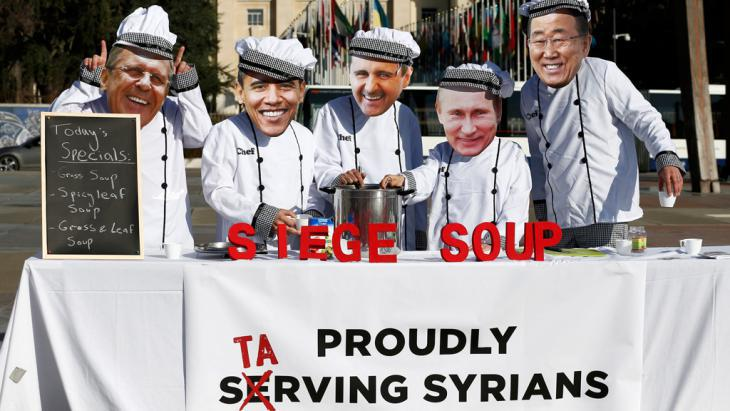 Activists protest against the Syria talks in Geneva (photo: Reuters/D. Balibouse)