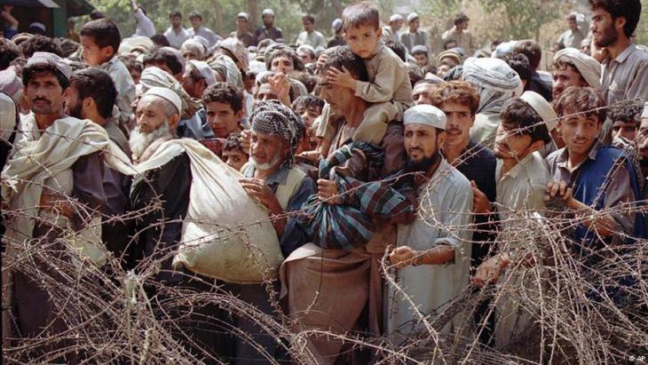 Afghan refugees behind a barbed wire fence at the border with Pakistan (photo: AP)