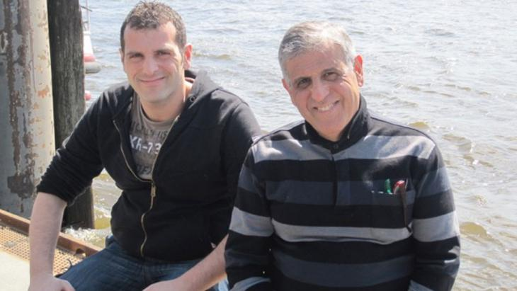 A snapshot of happier days: Mohammed Ghozi with one of his sons (photo: private)