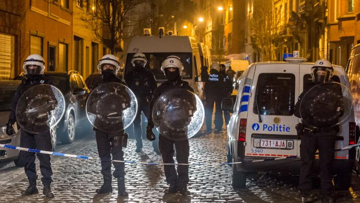 Police officers secure a street during a raid in the Molenbeek neighbourhood of Brussels, Belgium, Friday March 18, 2016. After an intense four-month manhunt across Europe and beyond, police on Friday captured Salah Abdeslam, the top fugitive in the Paris attacks in the same Brussels neighbourhood where he grew up (photo: AP/Geert Vanden Wijngaert)