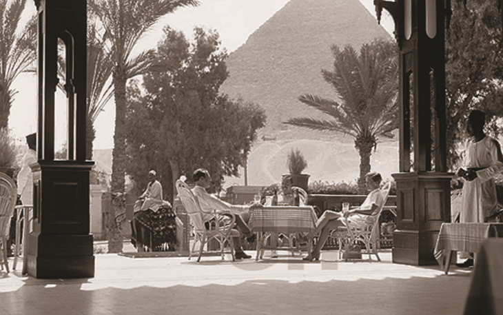 On the terrace at Mena House, ignoring the pyramids (source: grandhotelsofegypt.com)