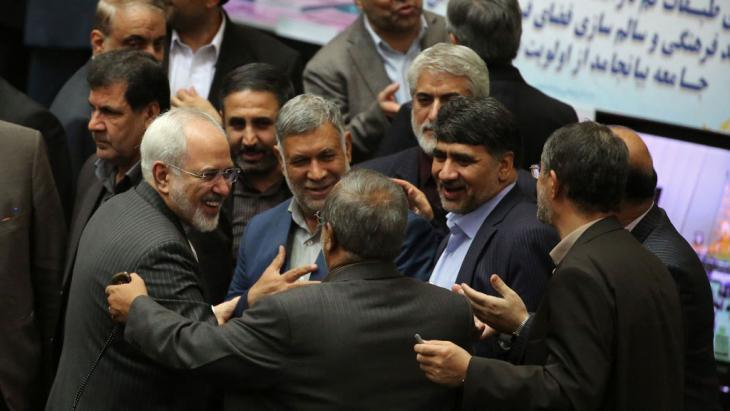 Foreign Minister Javad Zarif (left) being congratulated in the Tehran parliament on 17 January 2016 following the historic nuclear agreement (photo: Getty Images/AFP/A. Kenare)