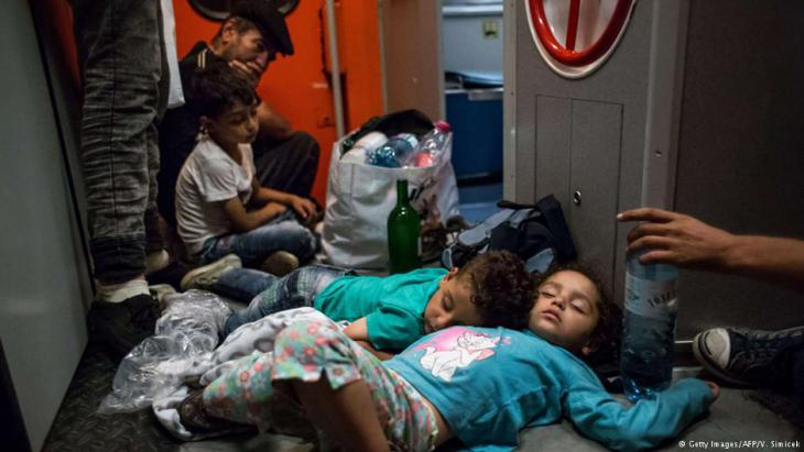 Exhausted refugee children en route through Hungary and Austria