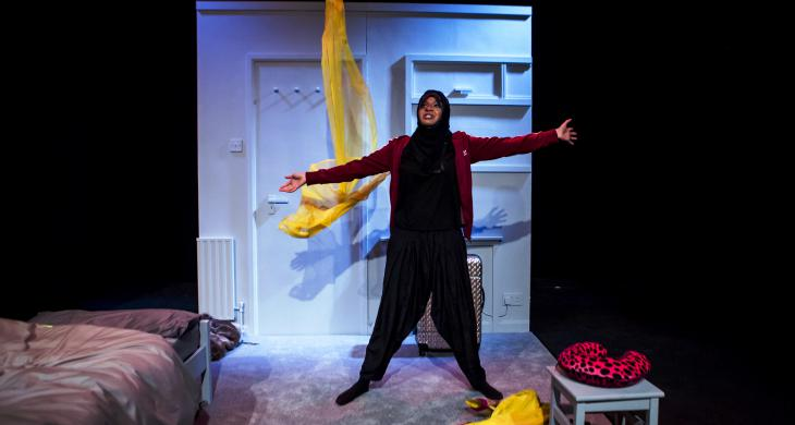 "Ambreen Razia performing in her one-woman play ""Diary of a Hounslow Girl"" (photo: Richard Davenport)"