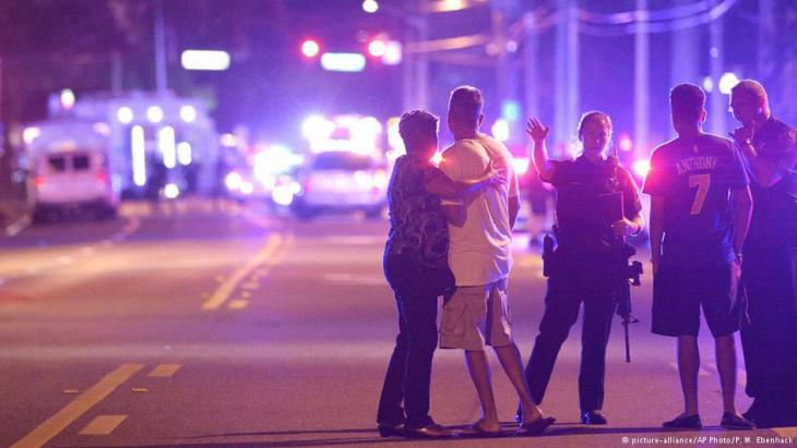 Orlando Police officers direct family members away from a fatal shooting at Pulse Orlando nightclub in Orlando, Fla., 12 June 2016 (photo: AP Photo/Phelan M. Ebenhack)