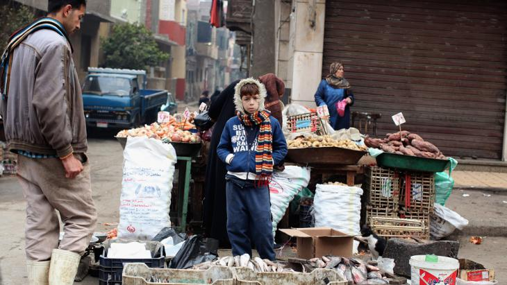Boy stands in front of a stall near one of Cairo's markets (photo: Getty Images/J. Mitchell)