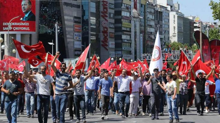 People wave national flags as they march from Kizilay square to Turkish General Staff building to react against the attempted military coup, in Ankara, on 16 July 2016 (photo: Getty Images/AFP/A. Altan)
