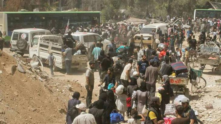 Evacuating Daraya (photo: Reuters/Sana)