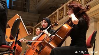 Young musicians belonging to the Arab Youth Philharmonic Orchestra performing in Berlin's Konzerthaus (photo: DW/Gero Schliess))