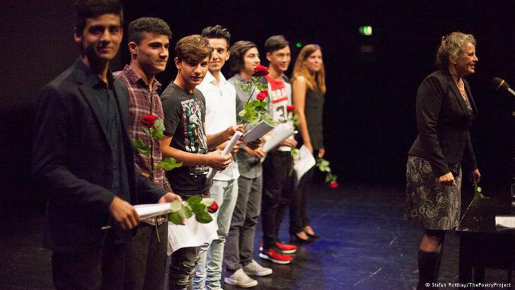 Poetry Project participants on stage with Susanne Koelbl (photo: