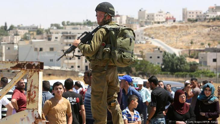 Israeli soldier guarding a checkpoint south of Hebron