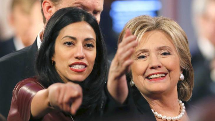 Huma Abedin (left) and Hillary Clinton (photo: Reuters)