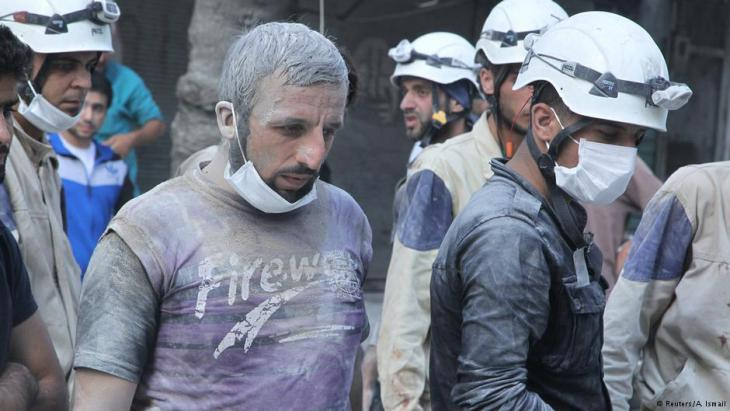 White Helmets in Aleppo look for survivors