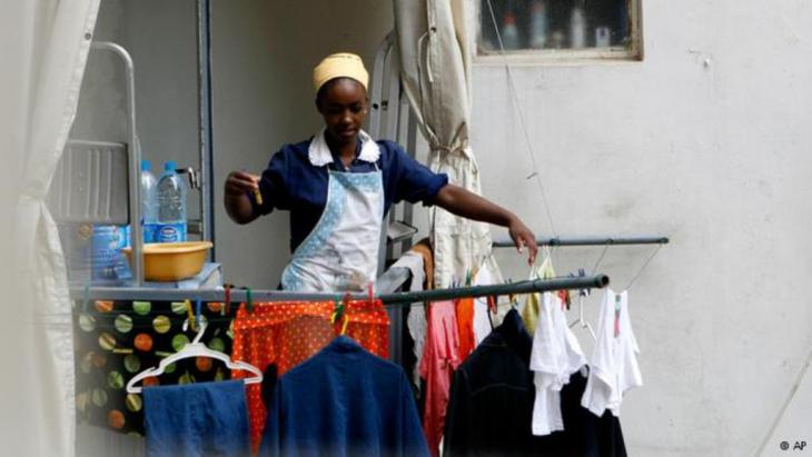 Ethiopian maid hanging out the washing