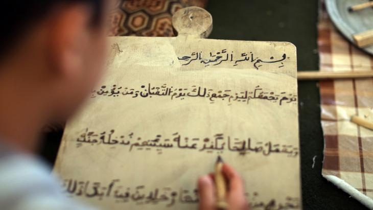 Boy studying the Koran in Tripoli (photo: MAHMUD TURKIA/AFP/Getty Images)