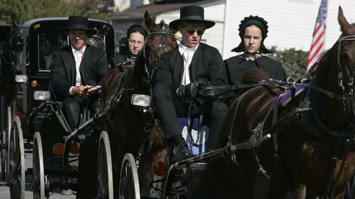 Members of the Old Order of the Amish in Bart Township, Pennsylvania (photo: Getty Images)