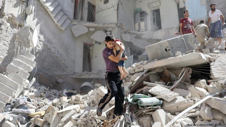 Boy being rescued from the rubble following a barrel bomb impact in eastern Aleppo
