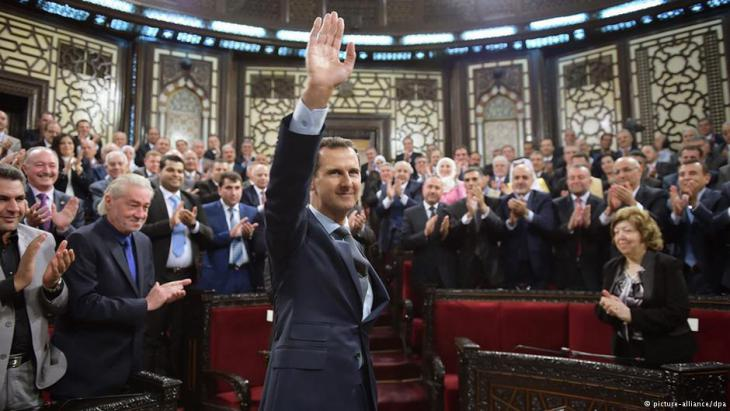 Assad surrounded by supporters in the Syrian parliament, summer 2016
