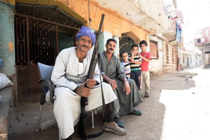 Christians guarding the church in Ezbeth Raflah (photo: Flemming Weiss-Andersen)