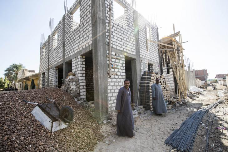 Younan Khalaf and the shell of his new house (photo: Flemming Weiss-Andersen)