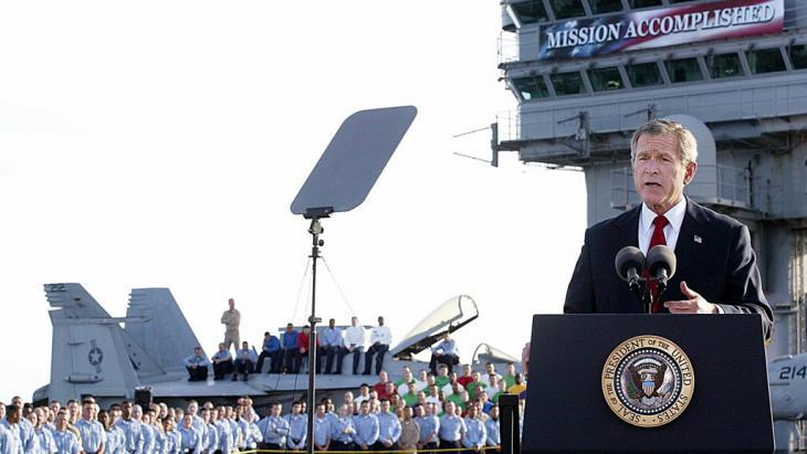 George W. Bush declares the end of the Iraq War from the aircraft carrier Abraham Lincoln on 1 May 2003 (photo: S. Jaffe/AFP/Getty Images)