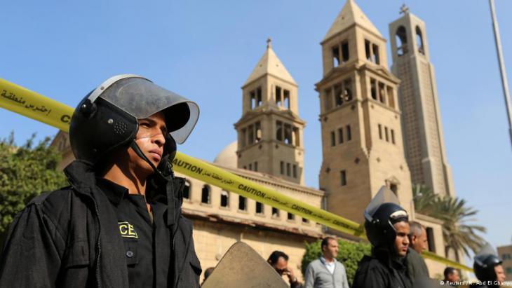 Police guard a Coptic church in Cairo (photo: Reuters)