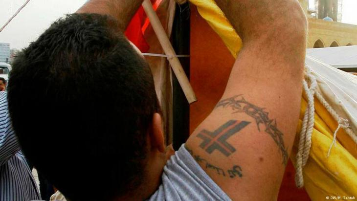 Man sporting a ″Lebanese Forces″ tattoo in Beirut (photo: Marwan Tahtah)