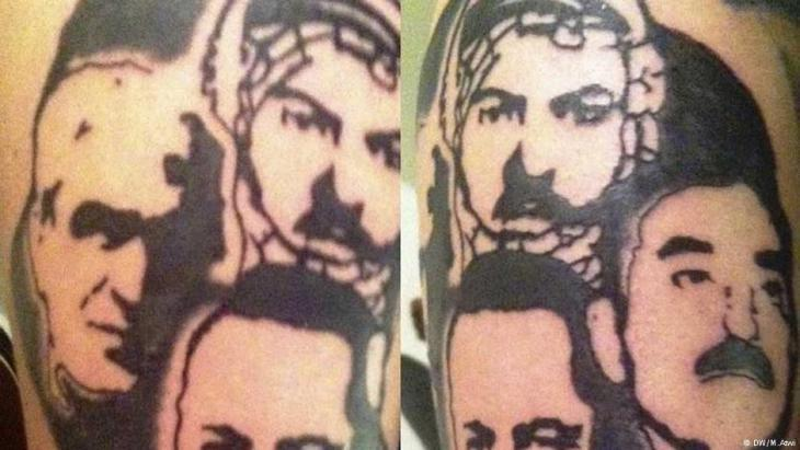 Man from Beirut with the faces of the leaders of the PFLP (People′s Front for the Liberation of Palestine) tattooed onto his biceps (photo: DW)