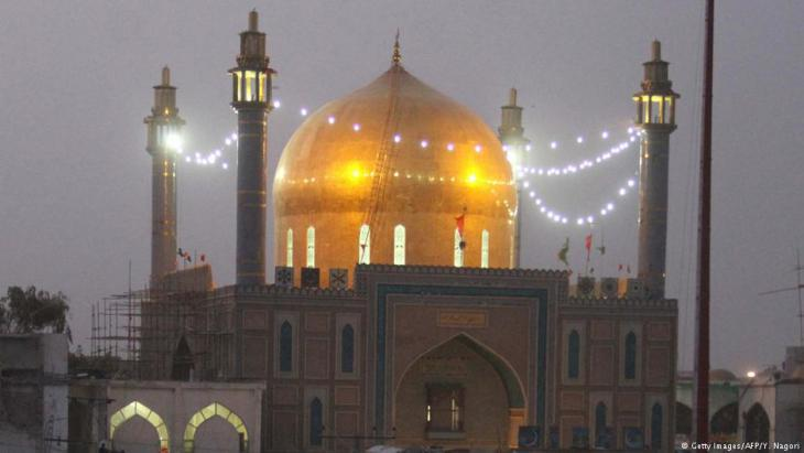 Lal Shahbaz Qalandar shrine at night (photo: Getty Images/AFP)