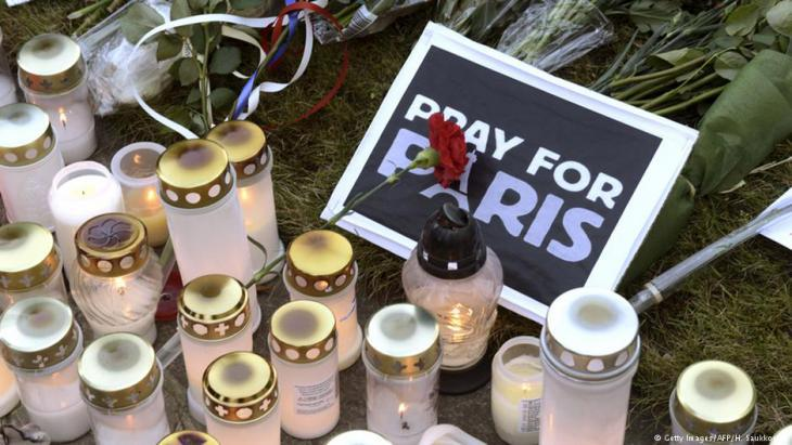 Mourning the victims of the Paris attacks on 13 November 2015 (photo: Getty Images/AFP)