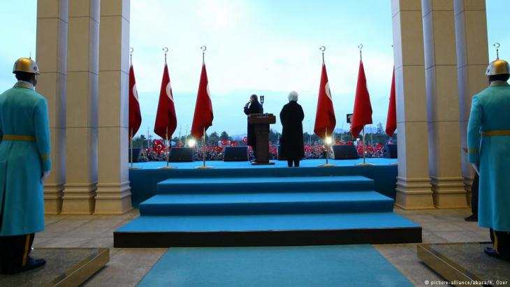 Turkish President Recep Tayyip Erdogan addresses crowds of cheering supporters at the Presidential Complex in Ankara on 17 April 2017