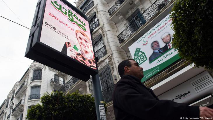 Election posters in Algiers encouraging people to vote in the upcoming parliamentary elections (photo: Getty Images/AFP)