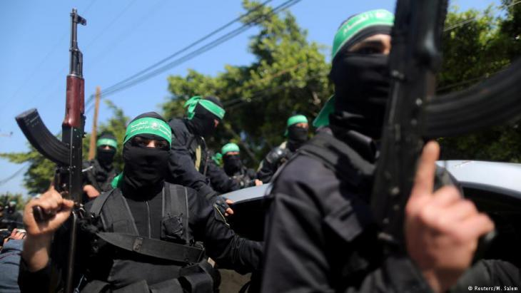 Militants belonging to the Palestinian Hamas group (photo: Reuters/M. Salem)